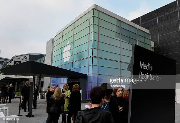 Attendees wait outside of the Yerba Buena Center for the start of the Apple Inc Spring Forward event in San Francisco California US on Monday March 9...