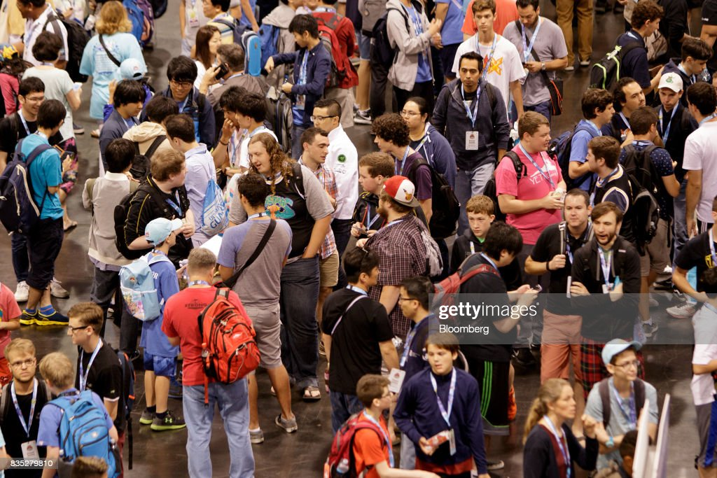 Attendees wait to enter the 2017 Pokmon Co. World Championships in Anaheim, California, U.S., on Friday, Aug. 18, 2017. The invitation-only event brings the best players from around the world to compete for the title of Pokémon TCG, Video Game, or Pokkén Tournament World Champion. Photographer: Troy Harvey/Bloomberg via Getty Images