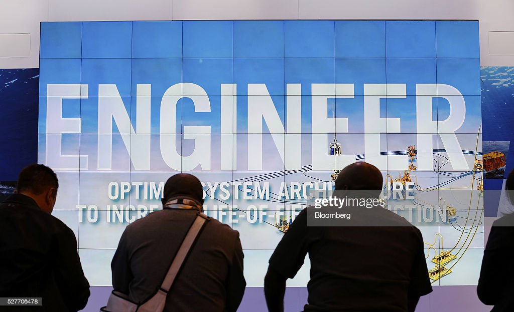 Attendees wait to watch a video at a booth during the 2016 Offshore Technology Conference (OTC) in Houston, Texas, U.S., on Tuesday, May 3, 2016. The OTC gathers energy professionals to exchange ideas and opinions to advance scientific and technical knowledge for offshore resources. Photographer: Aaron M. Sprecher/Bloomberg via Getty Images