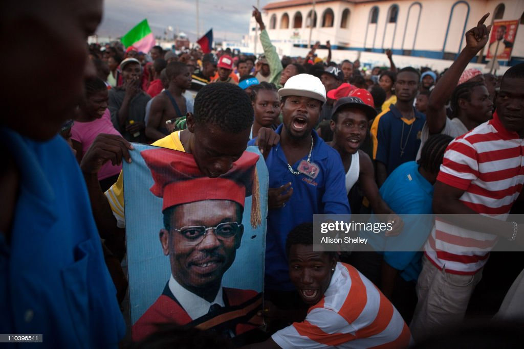 Attendees waiting for Haitian presidential candidate Michel Martelly rally for former Haitian president JeanBertrand Aristide in the Cite Soleil...