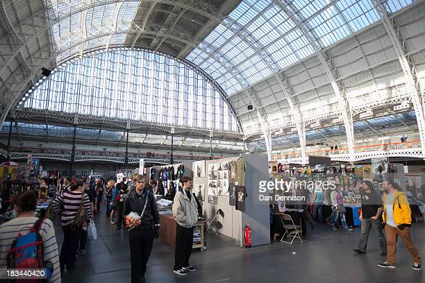 Attendees walk amongst the stalls at the London Film And Comic Con at Olympia Exhibition Centre on October 6 2013 in London England The event which...