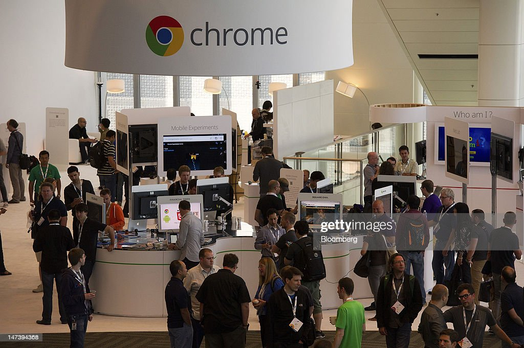 Attendees walk around the showroom floor during the Google I/O conference in San Francisco, California, U.S., on Thursday, June 28, 2012. Google Inc., owner of the world's most popular search engine, unveiled a cloud-computing service for building and running applications to help woo customers and challenge Amazon.com Inc.'s Web Services. Photographer: David Paul Morris/Bloomberg via Getty Images