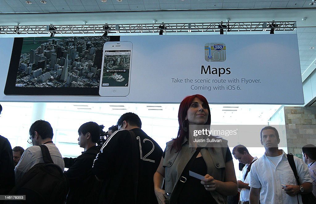 WWDC attendees walk by a poster for the new Maps application at the Apple 2012 World Wide Developers Conference (WWDC) at Moscone West on June 11, 2012 in San Francisco, California. Apple unveiled a slew of new hardware and software updates at the company's annual developer conference which runs through June 15.