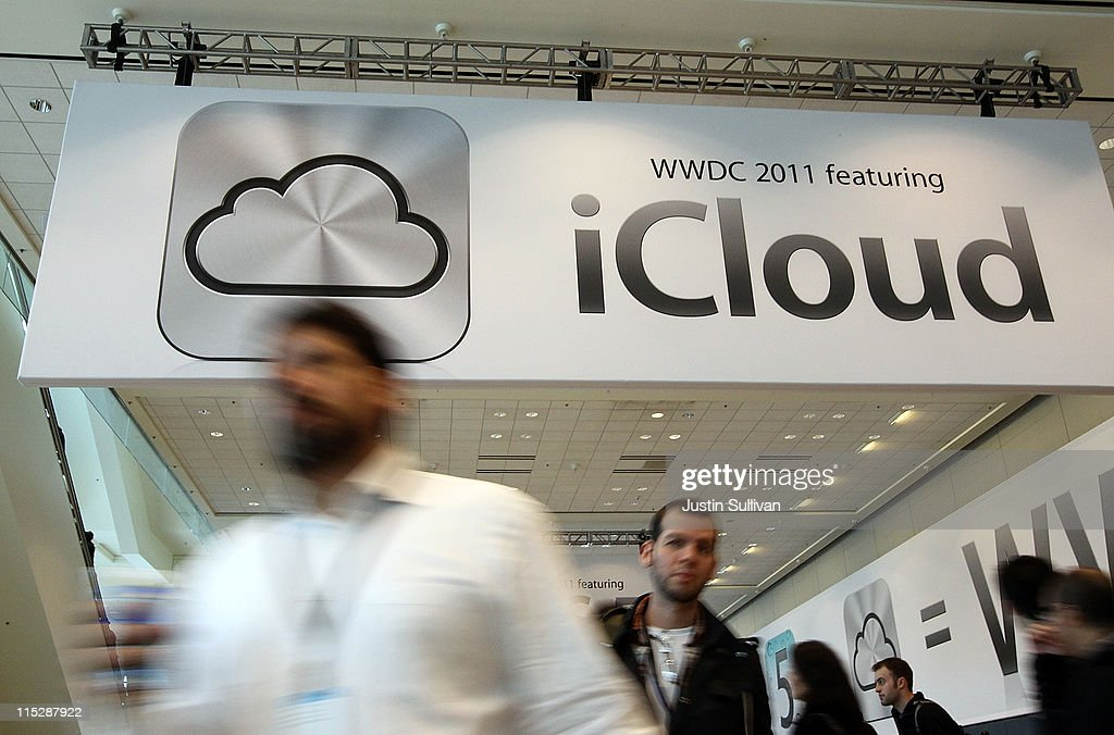 Attendees walk by a sign for the new iCloud during the 2011 Apple World Wide Developers Conference at the Moscone Center on June 6, 2011 in San Francisco, California. Apple CEO Steve Jobs returned from sick leave to introduce Apple's new iCloud storage system and the next versions of Apple's iOS and Mac OSX.