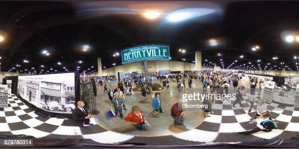 Attendees walk on the exhibit floor during the Berkshire Hathaway Inc annual meeting in Omaha Nebraska US on Saturday May 6 2017 Warren Buffett...