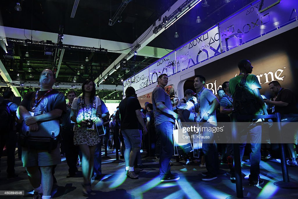 Attendees walk through different displays to play new games for the first time at E3 Electronic Entertainment Expo June 10, 2014 in Los Angeles, California. The annual video game conference and show runs June 10-12.