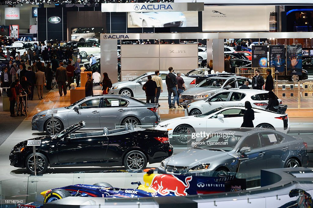 Attendees walk through the Los Angeles Convention floor looking at new cars during the Los Angeles Auto show on November 29, 2012 in Los Angeles, California. The LA Auto Show opens to the public on November 30 and runs through December 9.