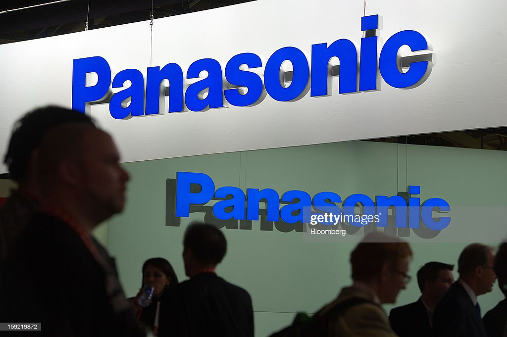 Attendees walk through the Panasonic Corp. booth at the 2013 Consumer Electronics Show in Las Vegas, Nevada, U.S., on Wednesday, Jan. 9, 2013. The 2013 CES trade show, which runs until Jan. 11, is the world's largest annual innovation event that offers an array of entrepreneur focused exhibits, events and conference sessions for technology entrepreneurs. Photographer: David Paul Morris/Bloomberg via Getty Images
