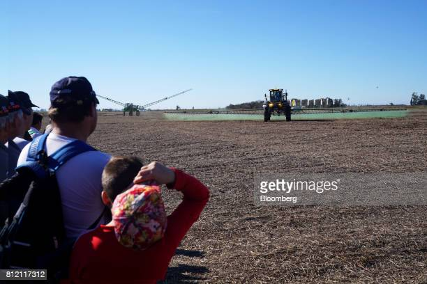 Attendees watch a demonstration of a PLA SA sprayer during the AgroActiva fair in Armstrong Santa Fe Argentina on Thursday June 1 2017 YPF SA the...