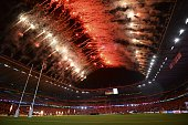Attendees watch a fireworks show during the opening ceremony of the 2015 Rugby World Cup at Twickenham stadium in south west London on September 18...