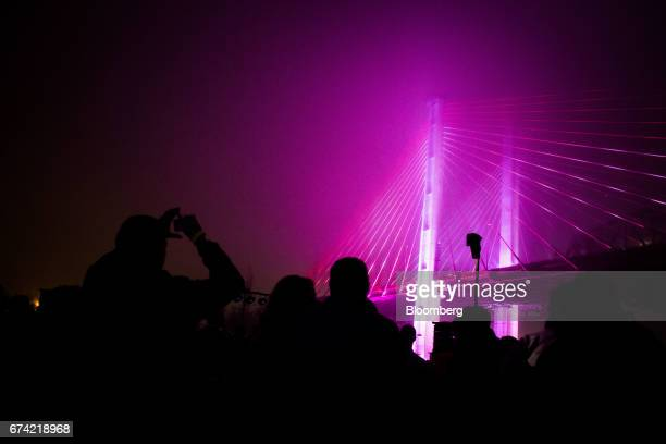 Attendees watch a light show at the grand opening of the new Kosciuszko Bridge in the Brooklyn borough of New York US on Thursday April 27 2017 On...