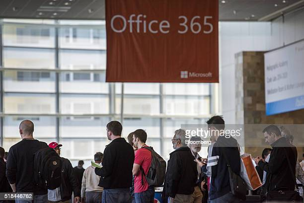 Attendees watch a presentation at the Microsoft Developers Build Conference in San Francisco California US on Thursday March 31 2016 Microsoft Chief...