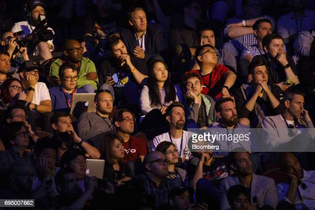 Attendees watch a preview during the Microsoft Corp Xbox One X reveal event ahead of the E3 Electronic Entertainment Expo in Los Angeles California...