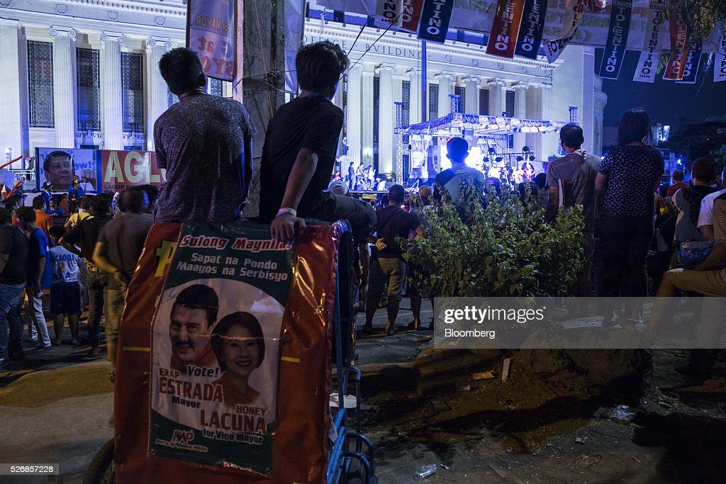 Attendees watch during a campaign rally for Rodrigo Duterte, mayor of Davao City and presidential candidate, not pictured, in Manila, the Philippines, on Sunday, May 1, 2016. Duterte, the crime-fighting mayor who is favored to win the Philippines May 9 presidential election, failed to declare tens of millions of dollars in assets, according to records released by a senator supporting rival candidate Grace Poe. Photographer: Taylor Weidman/Bloomberg via Getty Images