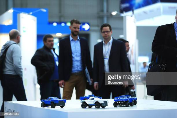 Attendees watch electronic toy cars at a stand promoting 5G connectivity and Nokia Bell Labs at the CeBIT 2017 tech fair in Hannover Germany on...