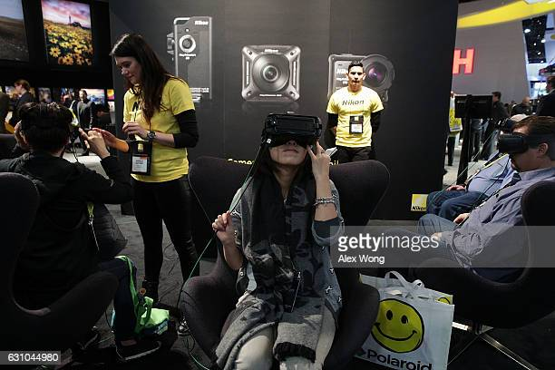 Attendees watch KeyMission 360 camera demo footage at the Nikon booth during CES 2017 at the Las Vegas Convention Center on January 5 2017 in Las...
