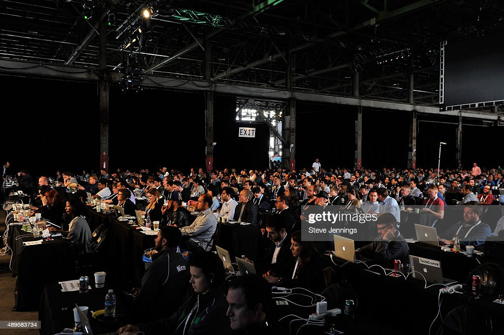 Attendees watch presentations during Startup Battlefield on day two of TechCrunch Disrupt SF 2015 at Pier 70 on September 22 2015 in San Francisco...