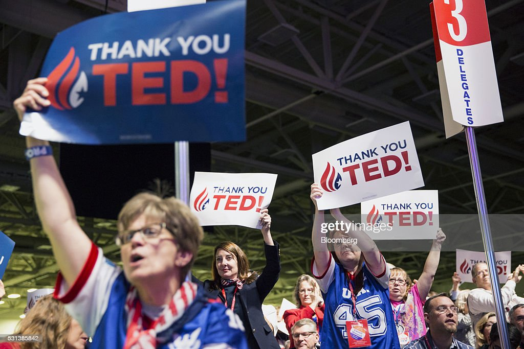 Attendees wave signs while listening to Senator Ted Cruz a Republican from Texas and former 2016 presidential candidate not pictured speak during the...