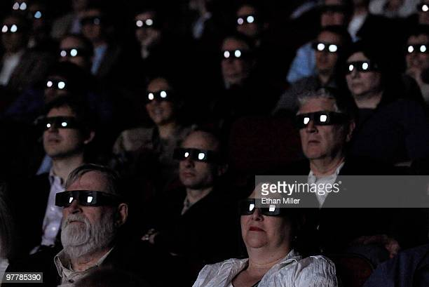 Attendees wear 3D glasses as they watch movie clips during a State of the Industry update at the Paris Las Vegas during ShoWest the official...