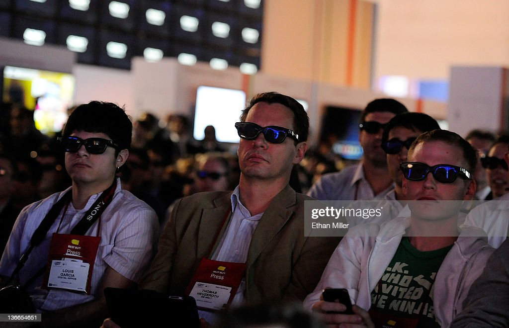 Attendees wear 3-D glasses during a Sony Corp. press event at the Las Vegas Convention Center for the 2012 International Consumer Electronics Show (CES) January 9, 2012 in Las Vegas, Nevada. CES, the world's largest annual consumer technology trade show, runs from January 10-13 and is expected to feature 2,700 exhibitors showing off their latest products and services to about 140,000 attendees.