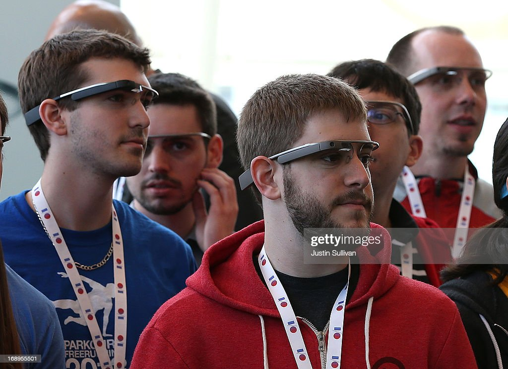 Attendees wear Google Glass while posing for a group photo during the Google I/O developer conference on May 17, 2013 in San Francisco, California. Eight members of the Congressional Bi-Partisan Privacy Caucus sent a letter to Google co-founder and CEO Larry Page seeking answers to privacy questions and concerns surrounding Google's photo and video-equipped glasses called 'Google Glass'. The panel wants to know if the high tech eyeware could infringe on the privacy of Americans. Google has been asked to respond to a series of questions by June 14.
