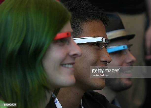 Attendees wear Google Glass while posing for a group photo during the Google I/O developer conference on May 17 2013 in San Francisco California...