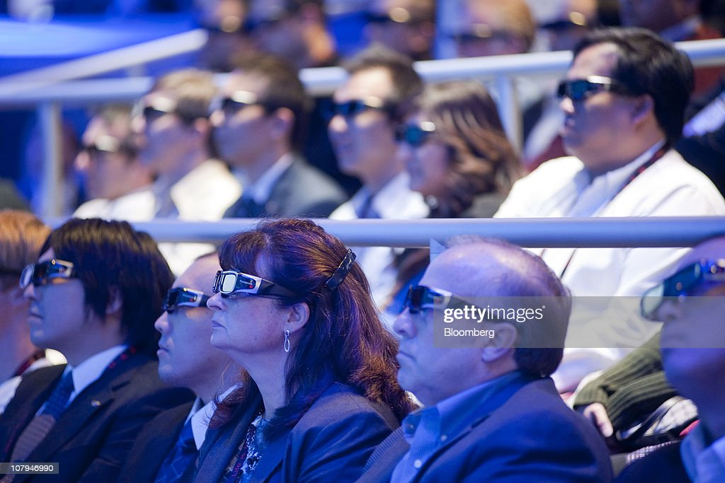 Attendees wear Panasonic Corp. 3D glasses during the 2011 International Consumer Electronics Show (CES) in Las Vegas, Nevada, U.S., on Saturday, Jan. 8, 2011. The 2011 CES tradeshow features 2,500 global technology companies presenting consumer tech products and is expected to draw over 100,000 attendees. Photographer: Jacob Kepler/Bloomberg via Getty Images