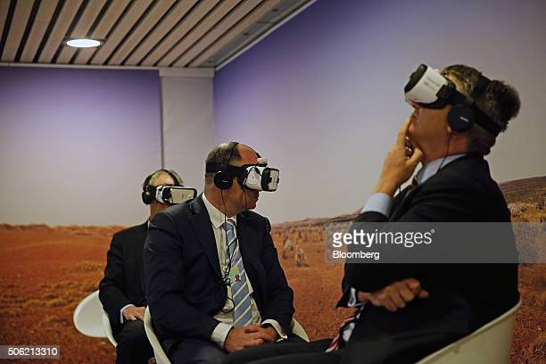 Attendees wear Samsung Gear VR virtual reality headset developed jointly by Oculus VR Inc and Samsung Electronics Co inside the Congress Center...
