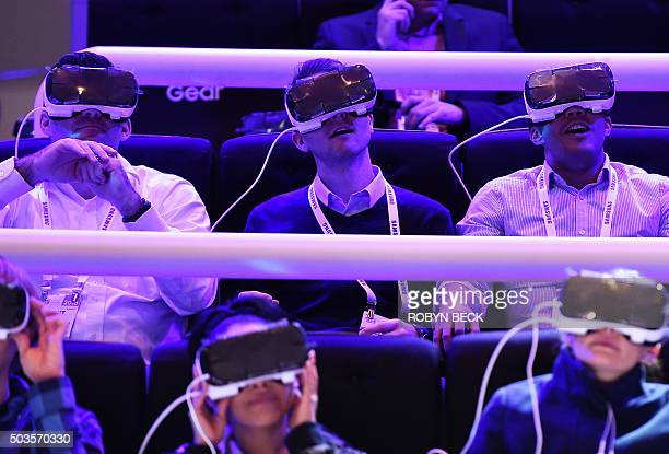 Attendees wear the Samsung Gear VR virtual reality headset at the Las Vegas Convention Center January 5 2016 in Las Vegas Nevada ahead of the CES...