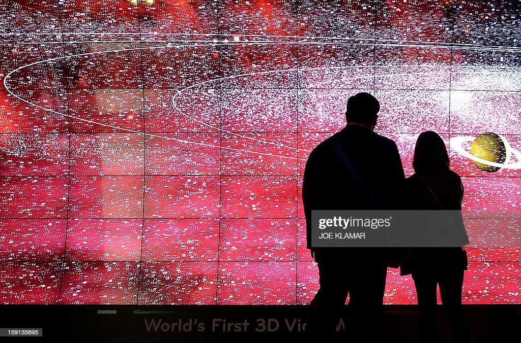 Attendees wearing 3-D glasses watch the world's first '3-D video wall' during a presentation at the LG booth during the 2013 International CES at the Las Vegas Convention Center on January 8, 2013 in Las Vegas, Nevada. CES, the world's largest annual consumer technology trade show, runs from January 8-11 and is expected to feature 3,100 exhibitors showing off their latest products and services to about 150,000 attendees.