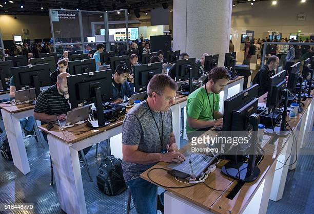 Attendees work in the coding competition booth at the Microsoft Developers Build Conference in San Francisco California US on Thursday March 31 2016...