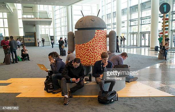 Attendees work on their laptop computers and smartphones ahead of the Google I/O Annual Developers Conference in San Francisco California US on...