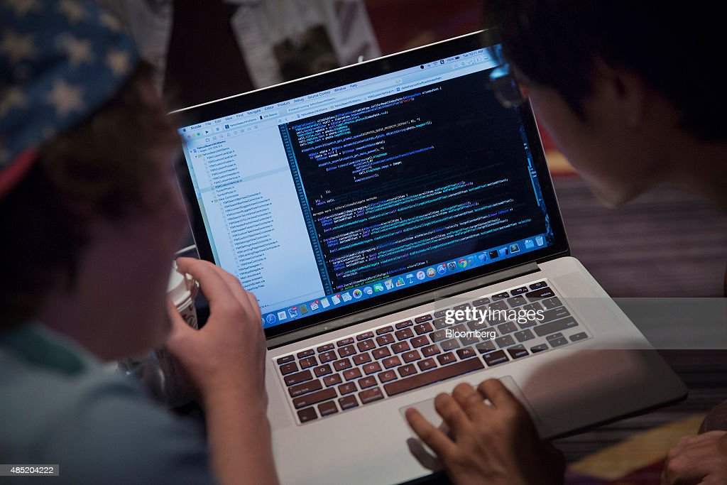 Attendees working on an Apple Inc. laptop computer participate in the Yahoo! Inc. Mobile Developer Conference Hackathon in New York, U.S., on Tuesday, Aug. 25, 2015. The Hackathon is an opportunity for mobile developers to come together and hack around the Yahoo! Inc. Mobile Developer Suite. Photographer: Victor J. Blue/Bloomberg via Getty Images