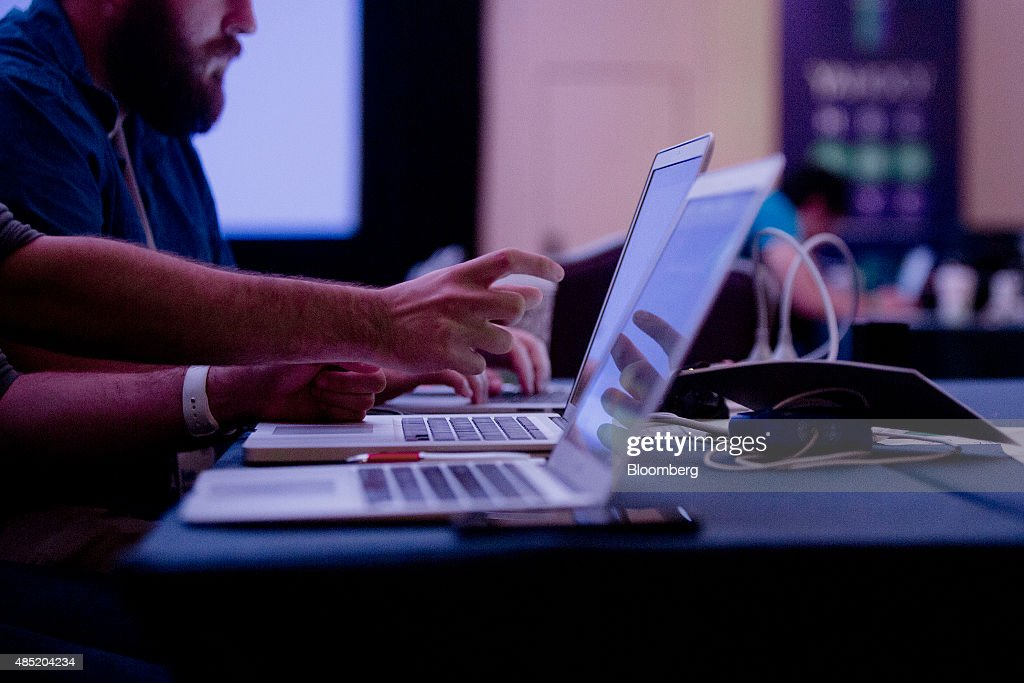 Attendees working on laptop computers participate in the Yahoo! Inc. Mobile Developer Conference Hackathon in New York, U.S., on Tuesday, Aug. 25, 2015. The Hackathon is an opportunity for mobile developers to come together and hack around the Yahoo! Inc. Mobile Developer Suite. Photographer: Victor J. Blue/Bloomberg via Getty Images