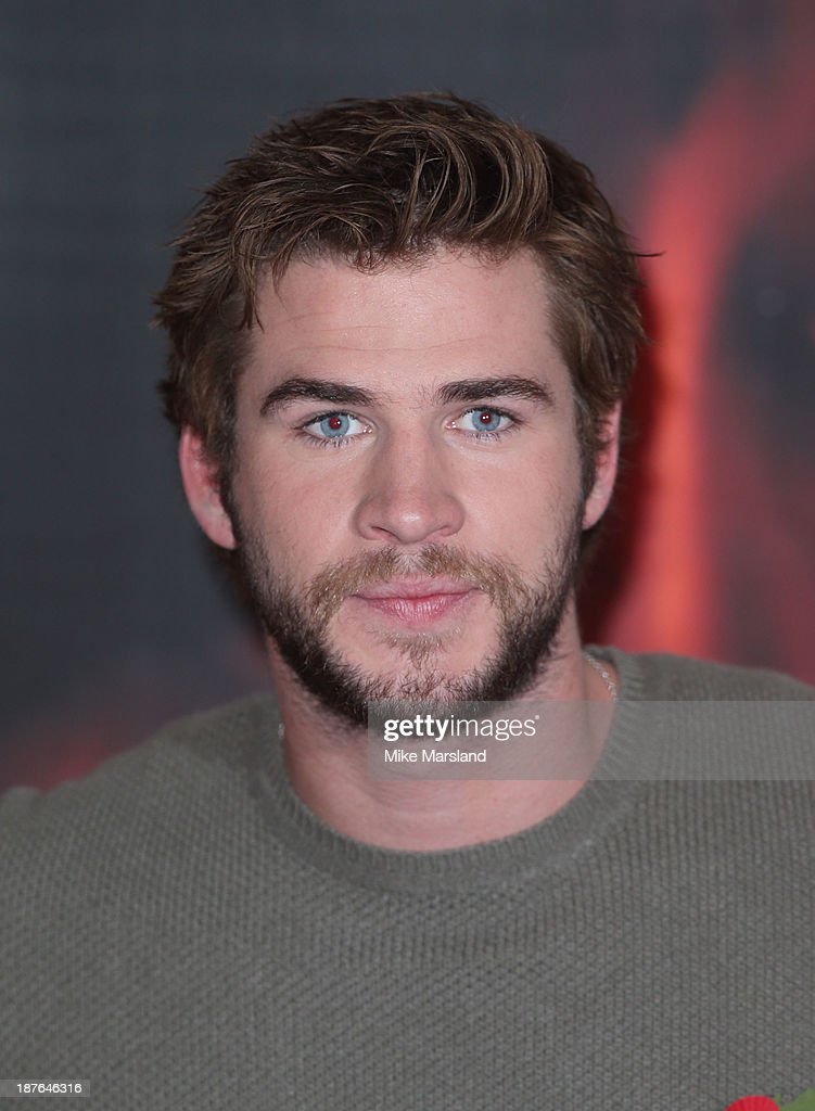 attends a photocall for 'The Hunger Games: Catching Fire' on November 11, 2013 in London, England.