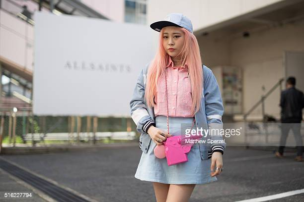 EUNBI attends the Allsaints presentation during Tokyo Fashion Week wearing a vintage gun bag Forty Seven Brand hat vintage shirt and jacket and Bata...