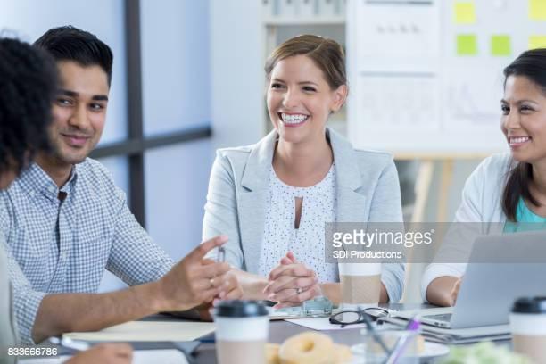 Attentive businesspeople attend breakfast meeting