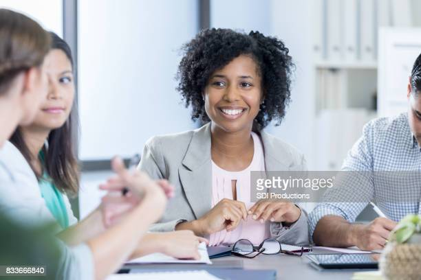 Attentive CEO listens to colleague during meeting