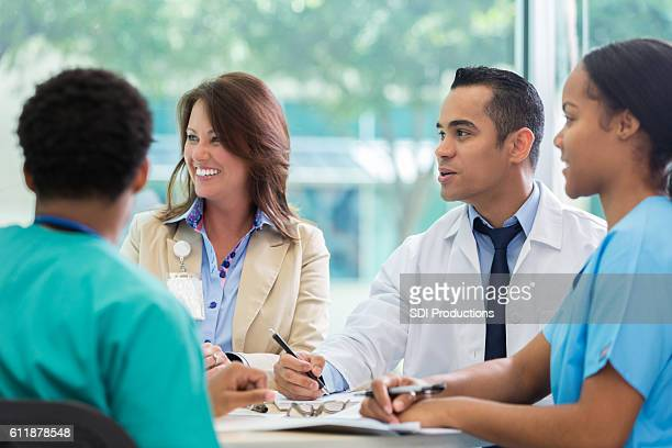 Attentive medical professionals during meeting