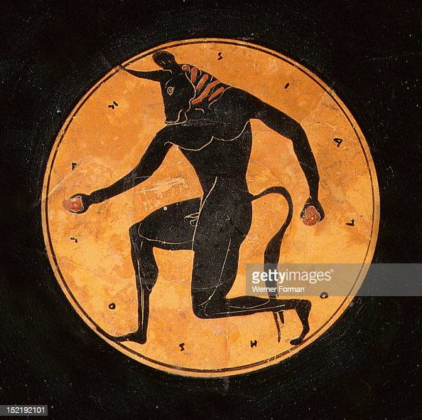 Attic bilingual eye cup with black figure interior depicting running minotaur and inscription reading the boy is beautiful Exterior painting depicts...