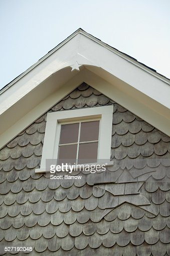 Attic window on a summer cottage : Stock Photo
