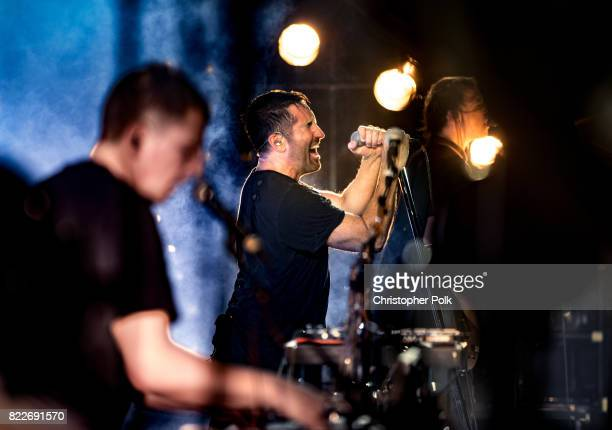 Atticus Ross Trent Reznor and Robin Finck of Nine Inch Nails perform onstage on day 3 of FYF Fest 2017 at Exposition Park on July 23 2017 in Los...