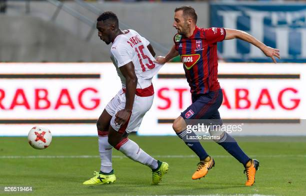 Attila Fiola of Videoton FC tries to stop Alexandre Mendy of FC Girondins de Bordeaux during the UEFA Europa League Third Qualifying Round Second Leg...