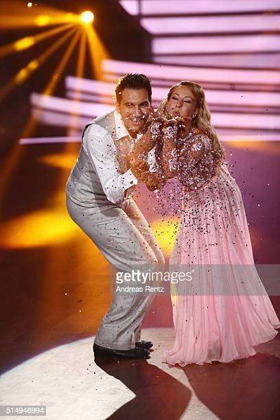 Attila Hildmann and Oxana Lebedew perform on stage during the 1st show of the television competition 'Let's Dance' on March 11 2016 in Cologne Germany