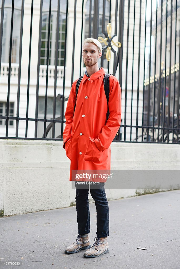 Attila Layos poses wearing a Diptych jacket, Levi's trousers, Doc. Martens boots and Stella McCartney X Adidas backpack before Atelier Versace show on July 6, 2014 in Paris, France.