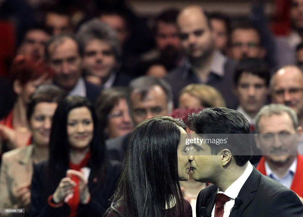 Attila Mesterhazy, chairman of Hungarian Socialist Party kisses his wife at an annual convention of the Hungarian Socialist Party on March 9, 2013 in Budapest. AFP PHOTO/Peter Kohalmi