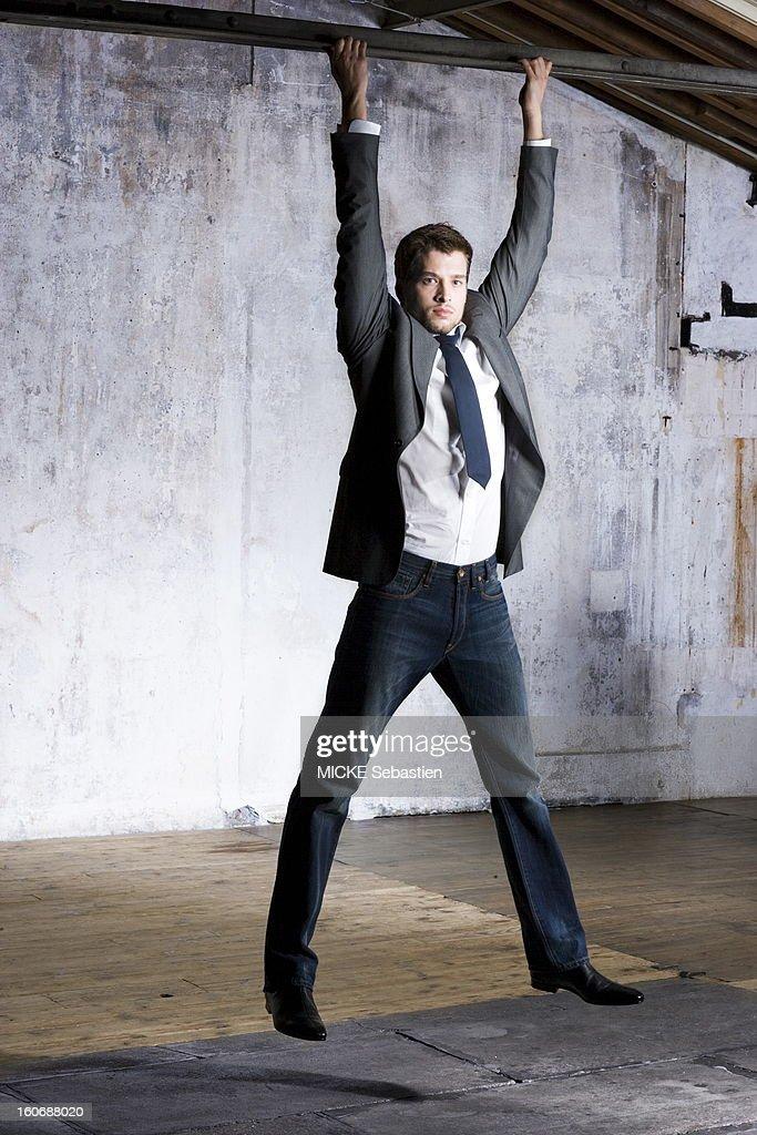 Attitude of a model has a suspended beam wearing a gray jacket has two pockets tiny turquoise dots PAUL amp JOE tuxedo shirt in white poplin Yves...