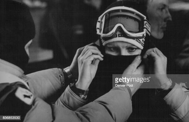 Attn Joan White Aided by her husband Bernie Hollingsworth of Wichita Kansas braces herself for the just above zero temperatures in the Rockies...