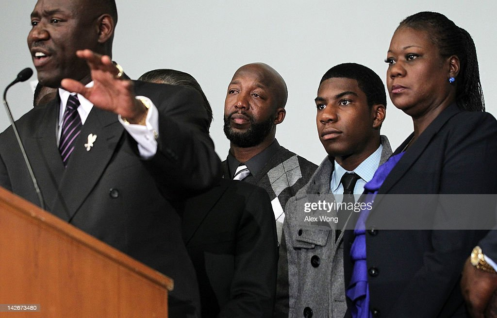 Attorney <a gi-track='captionPersonalityLinkClicked' href=/galleries/search?phrase=Benjamin+Crump+-+Attorney&family=editorial&specificpeople=9042867 ng-click='$event.stopPropagation()'>Benjamin Crump</a> (L) speaks as family of Trayvon Martin who was fatally shot by neighborhood watch captain George Zimmerman in Florida, mother <a gi-track='captionPersonalityLinkClicked' href=/galleries/search?phrase=Sybrina+Fulton&family=editorial&specificpeople=9024062 ng-click='$event.stopPropagation()'>Sybrina Fulton</a> (R), brother <a gi-track='captionPersonalityLinkClicked' href=/galleries/search?phrase=Jahvaris+Fulton&family=editorial&specificpeople=9127314 ng-click='$event.stopPropagation()'>Jahvaris Fulton</a> (2nd R), and father <a gi-track='captionPersonalityLinkClicked' href=/galleries/search?phrase=Tracy+Martin+-+Father+of+Trayvon+Martin&family=editorial&specificpeople=9075765 ng-click='$event.stopPropagation()'>Tracy Martin</a> (3rd R) listens during a news conference April 11, 2012 in Washington, DC. It has been reported that Zimmerman will be charged in the Trayvon Martin shooting according to Florida special prosecutor Angela Corey.