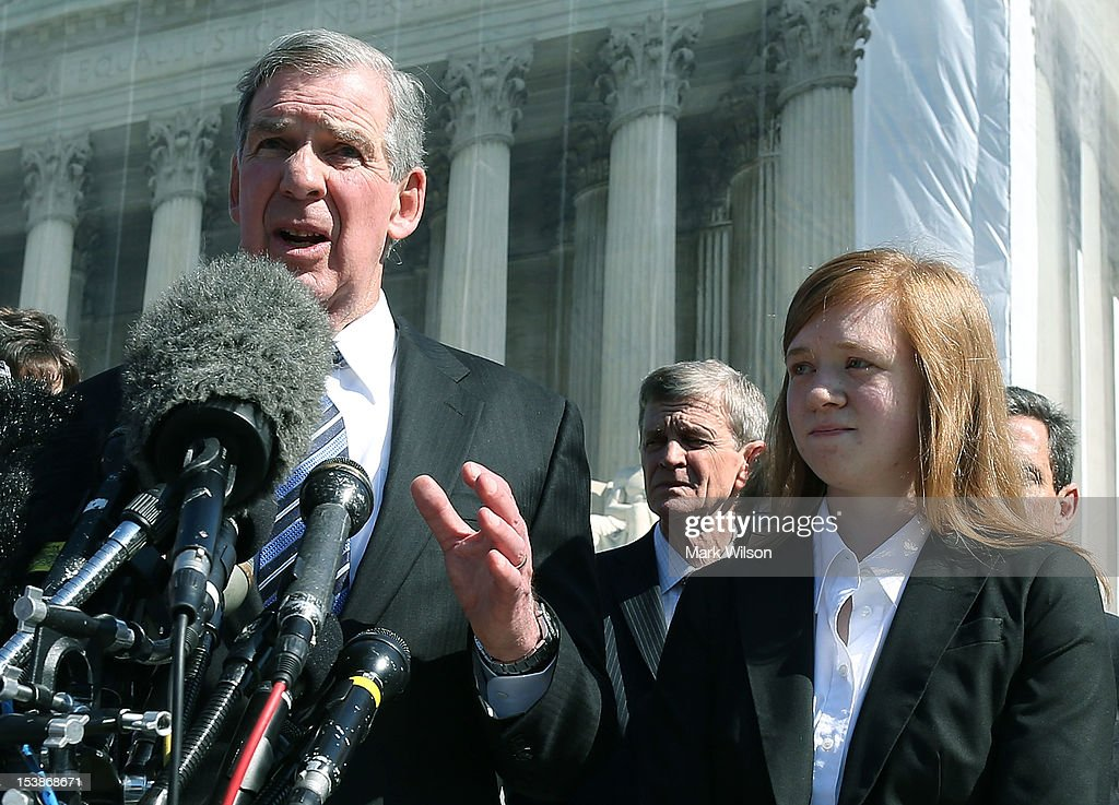 Attorney Bert Rein speaks to the media while standing with plaintiff Abigail Noel Fisher after the US Supreme Court heard arguments in her caseon...